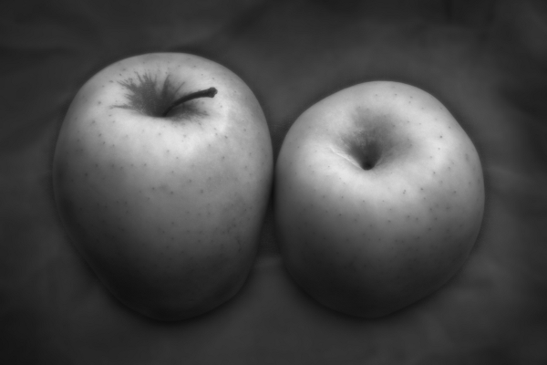 Two apples on a linen tablecloth